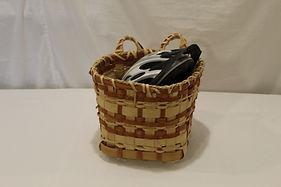 Orange bicycle basket with helmet.JPG