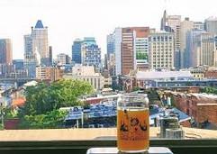 bacchus beer glass overlooking a city sk