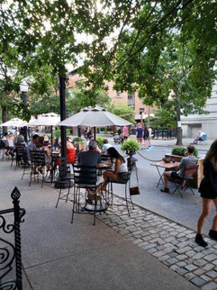 Sidewalk tables with people