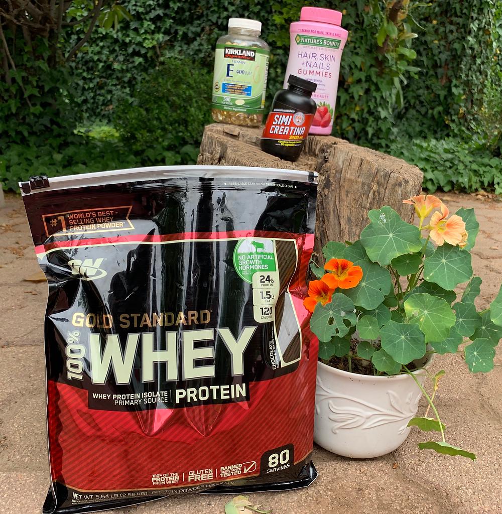 Whey protein, vitamin E, creatine, & biotin (left to right)