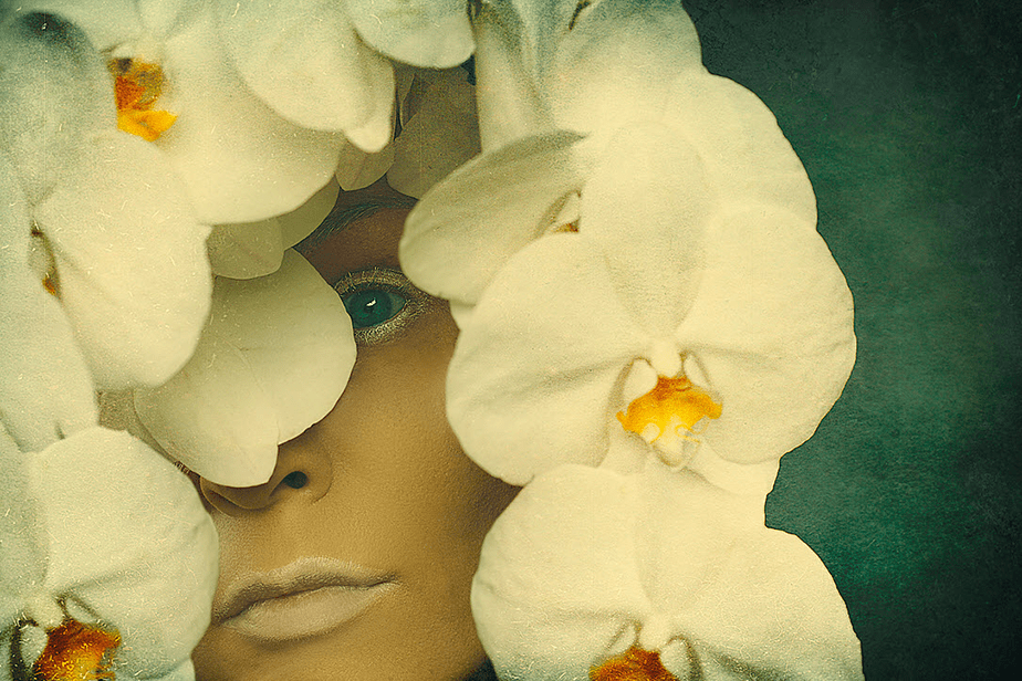 Photo of woman with flowers by Cheeky Ingel