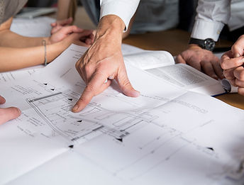 Finger pointing to construction plans