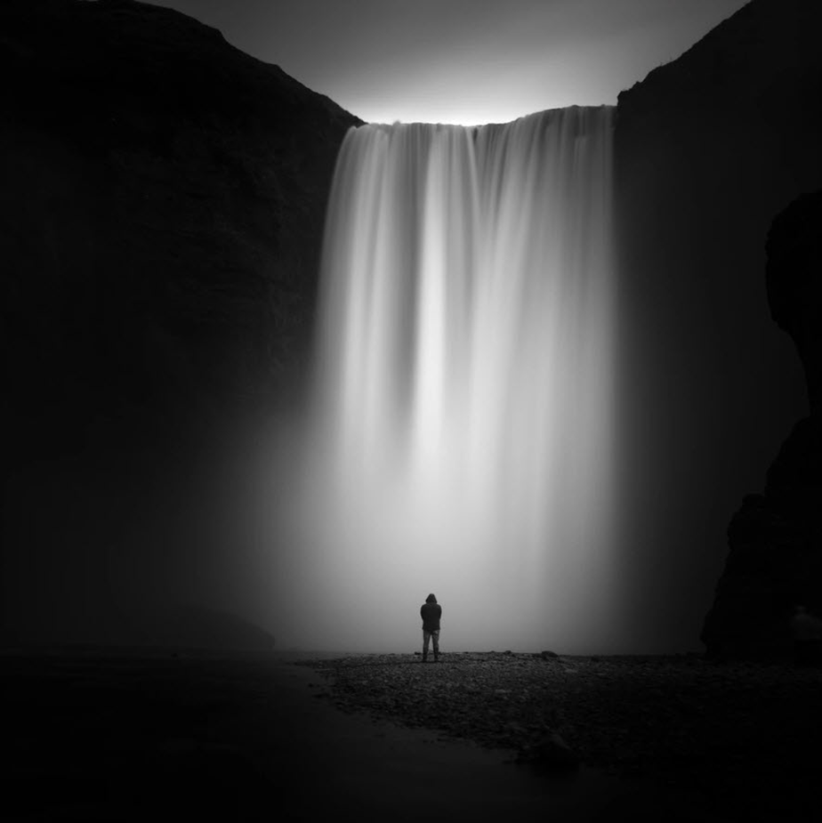 Black and white photograph of waterfall by Jay Vulture