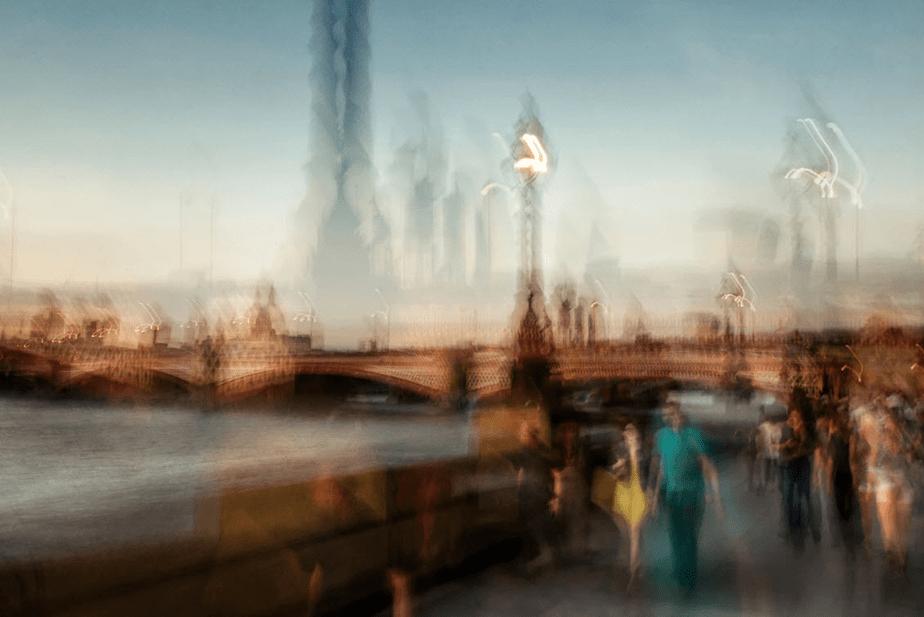 Blurry photo of city by Hernandez Binz