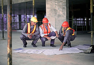 Contractors looking at plans