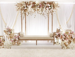 Gold metal backdrop with fresh or silk f