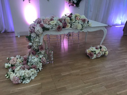 Sweetheart table with artificial flowers