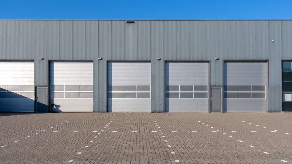 Row of grey industrial Units with roller