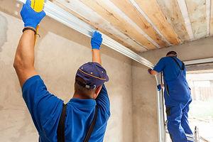 Garage doors installation. Workers insta