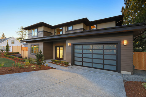 New construction home exterior with cont