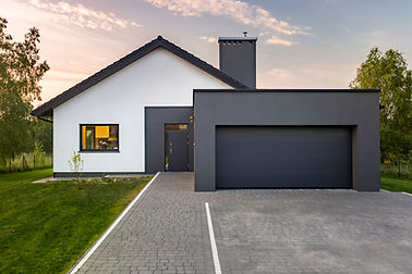 Modern house with garage and green lawn,