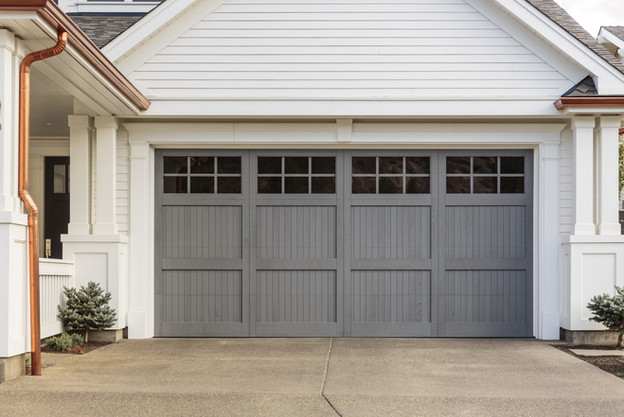 Gray garage door that is closed.jpg