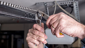Tools are used to work on a garage door