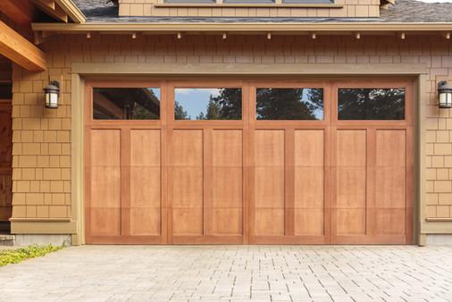 Closed brown garage door with windows.jp
