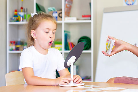 girl with mirror and speech cards