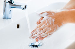 Woman use soap and washing hands under t