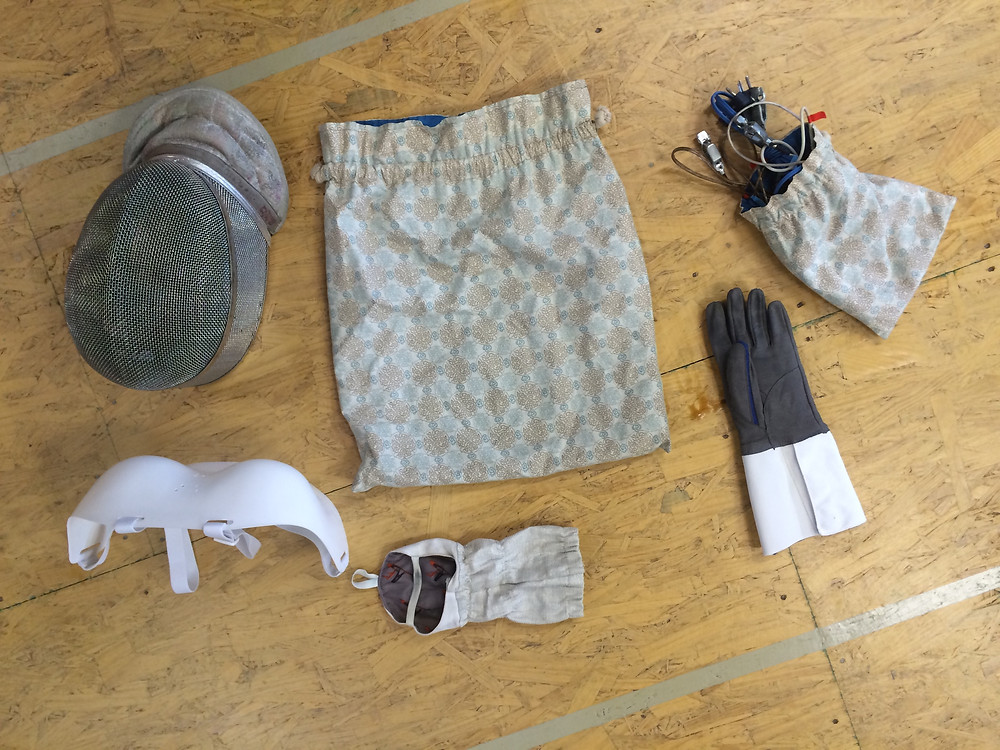 Mask, chest protector, glove, cuff, cord bag