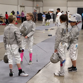Mylene fencing with friends