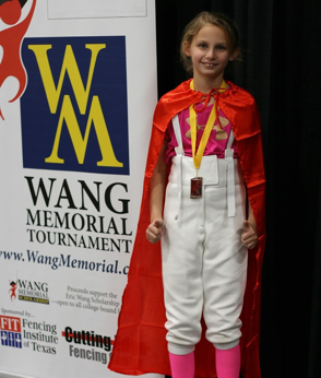 Mylene with medal and cape