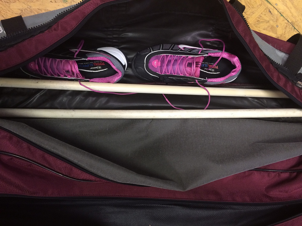 Fencing shoes with blades in bag