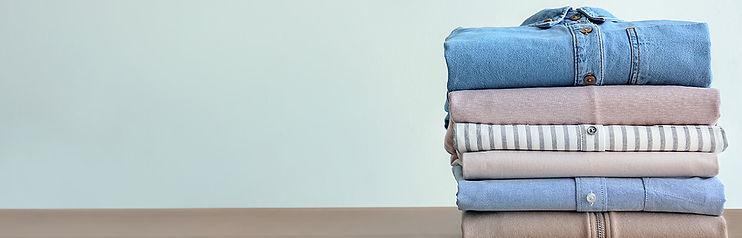 Laundry Service, Wash & Fold, stack of neatly folded laundry