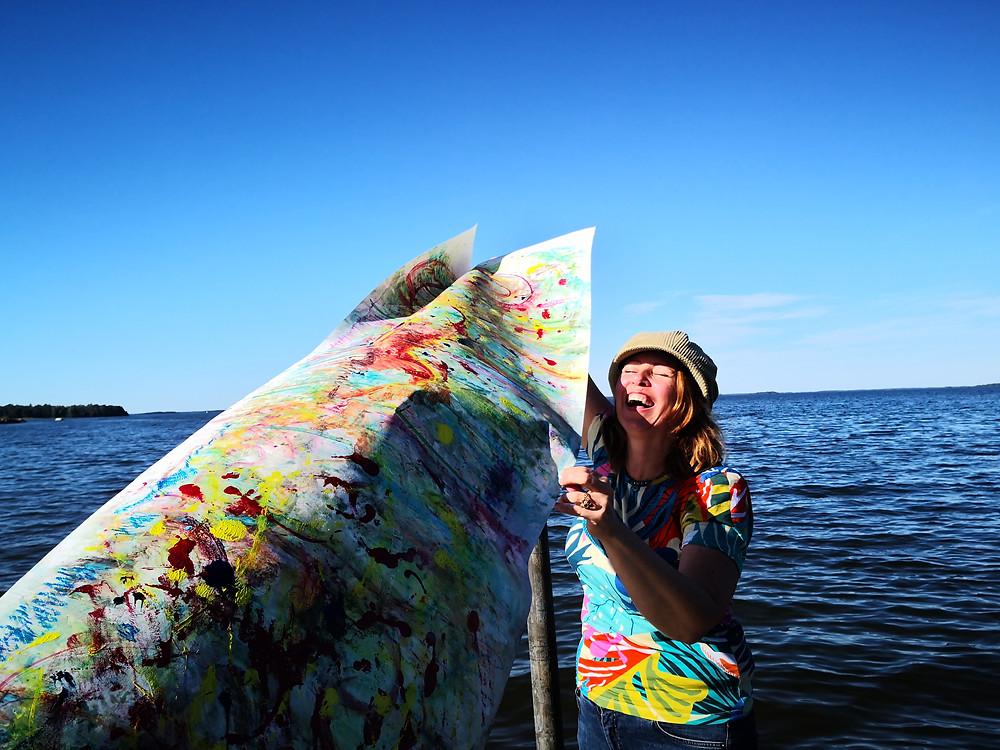 A photo of Ingela Johansson creating outdoors.