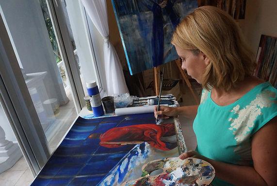 Ingela Johansson painting in the studio