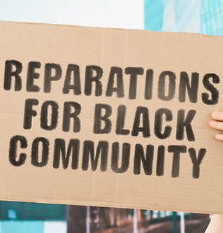 """The phrase """" Reparations for black commu"""
