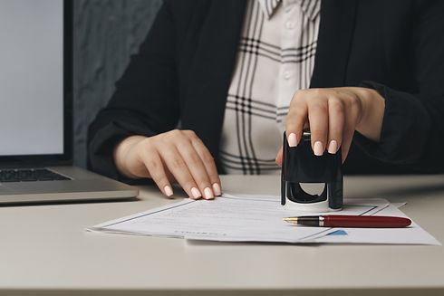 close-up-woman-s-notary-public-hand-stam