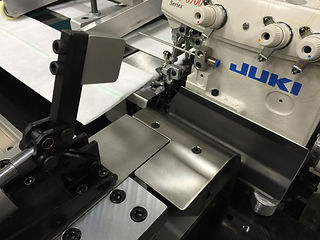 Sewing machine integrated into custom automation.