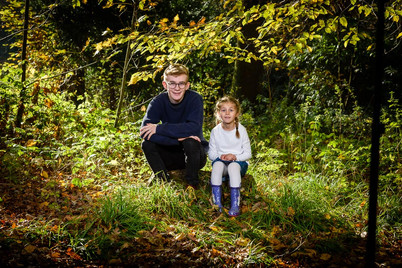 The Brother & Sister playing in the woods by Adam Soller Photography