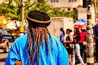 A rasta man walking of the streets of Sa