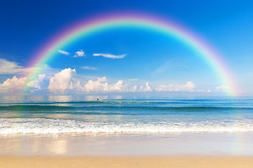 Beautiful Sea With A Rainbow In The Sky.