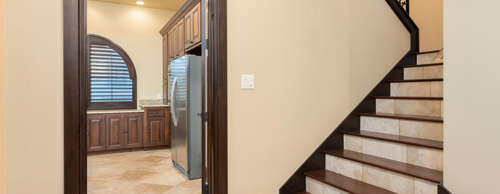 Butlers Kitchen and Stairs to Game Room