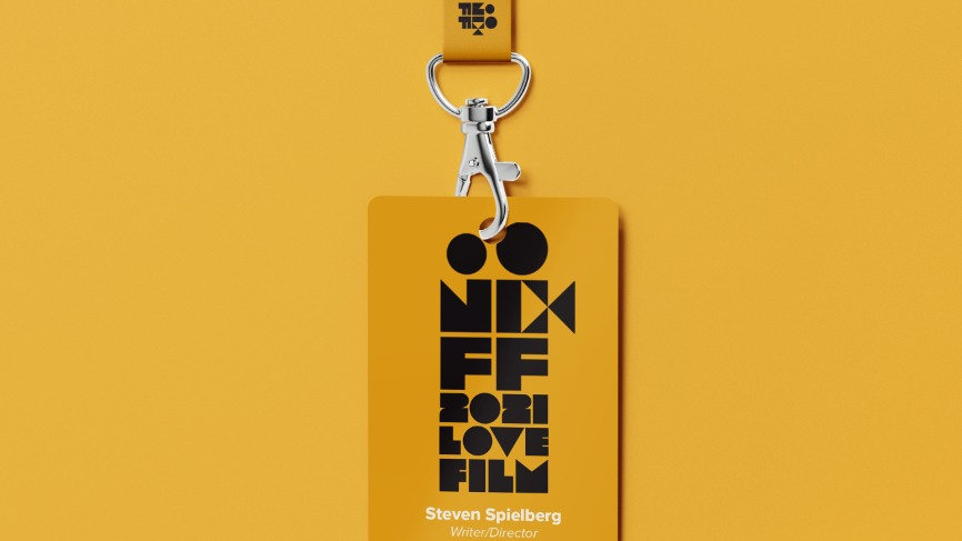A yellow badge with the NCFF logo hangs from a yellow lanyard. Finalized VIP passes/badge may look slightly different.