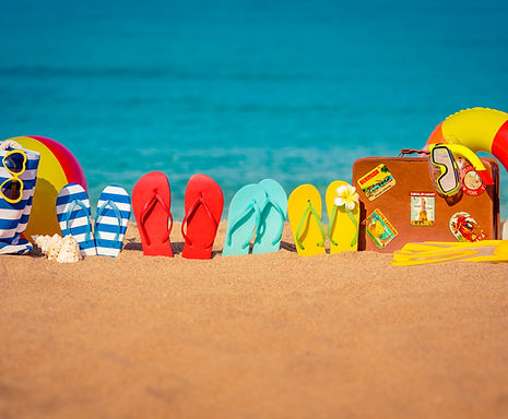 Flip-flops, beach ball and vintage suitc