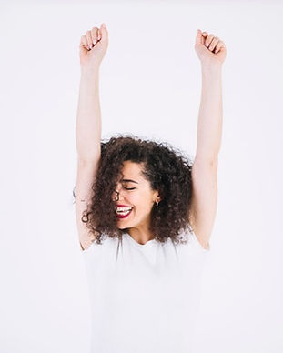 cheerful-woman-with-raised-arms_23-21477