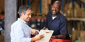 A Speedy's service inspector providing a written pest control report to a customer