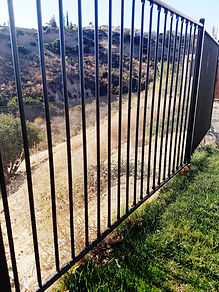 A perimeter gate with wire fencing