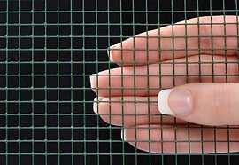 an image of a hand touching screen material