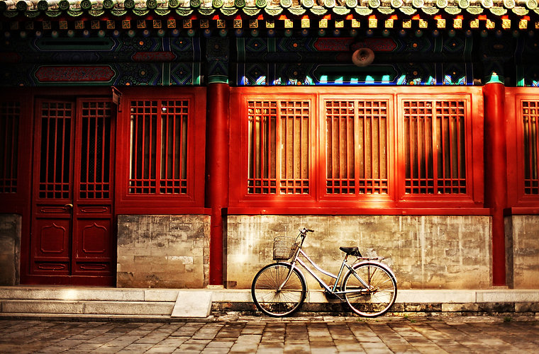 One bicycle in front of oriental red bui
