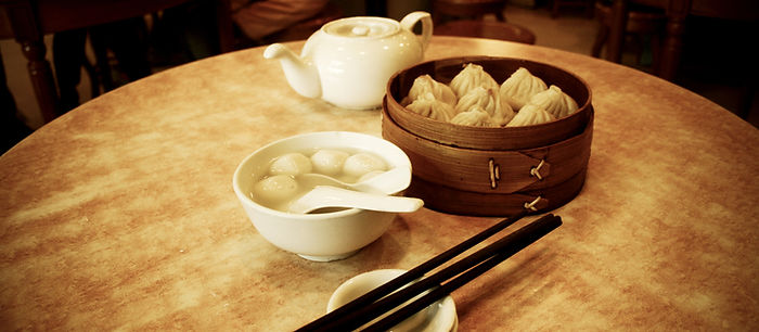 Chinese steamed dimsum in bamboo contain