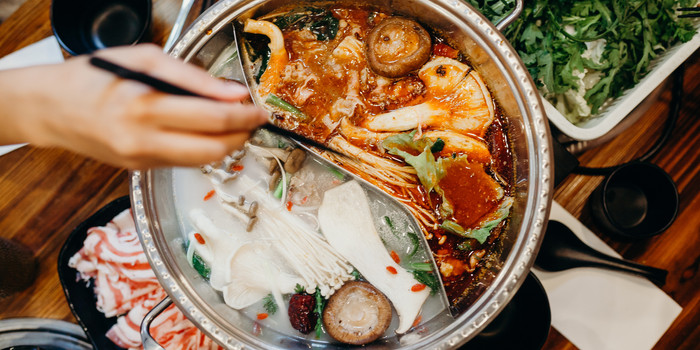 Korean hot pot meal.jpg Hands taking foo