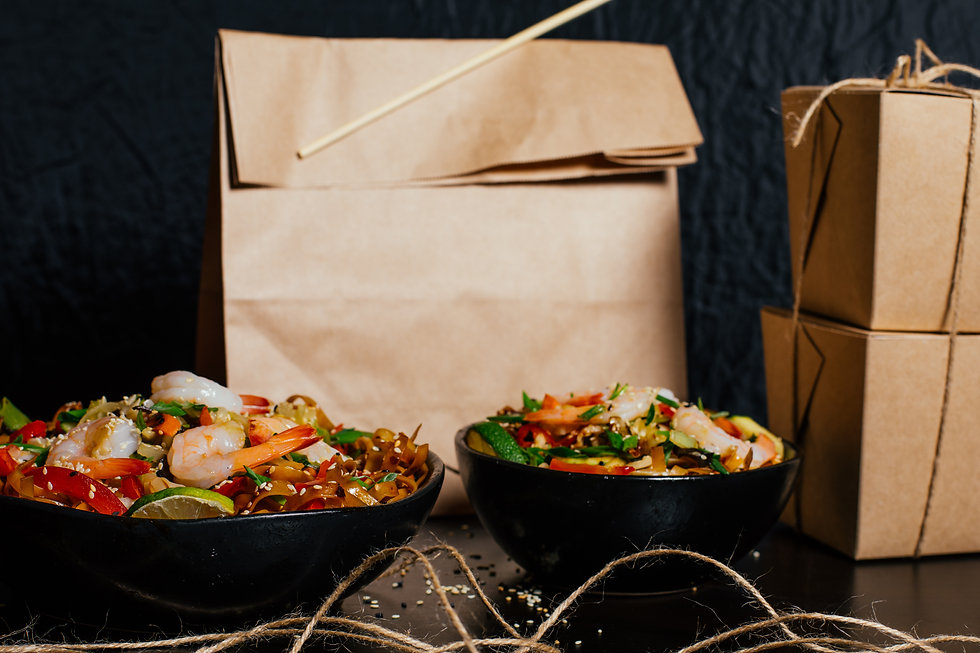 Wok fast food take away package with a gift and in a plates.jpg