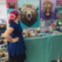 Amanda Rose Warren Admiring her Rosie Bear Original at the 2017 Girdwood forest fair