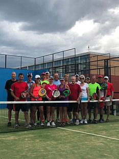 A large group of people gathered together to play a padel tennis tournament in Calgary