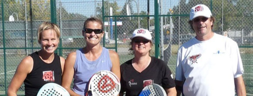 Four smiling people after a great padel tennis match at an outdoor court in Alberta, Canada