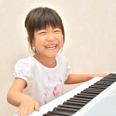 Girls playing the piano.jpg