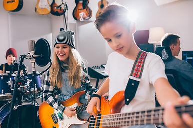 kids rock band playing instruments in mu
