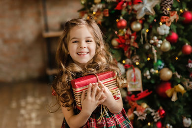 Happy little smiling girl with christmas